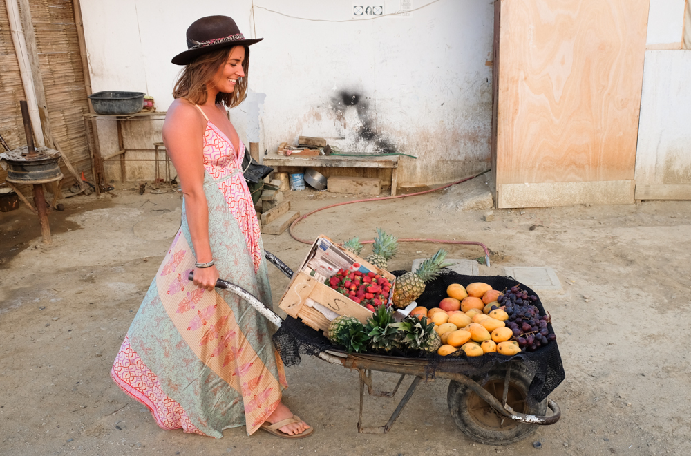 Emily with fresh vegetables in Peru