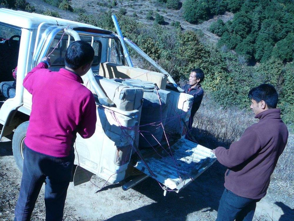 Unloading equipment to potter to Pasavar village.jpg