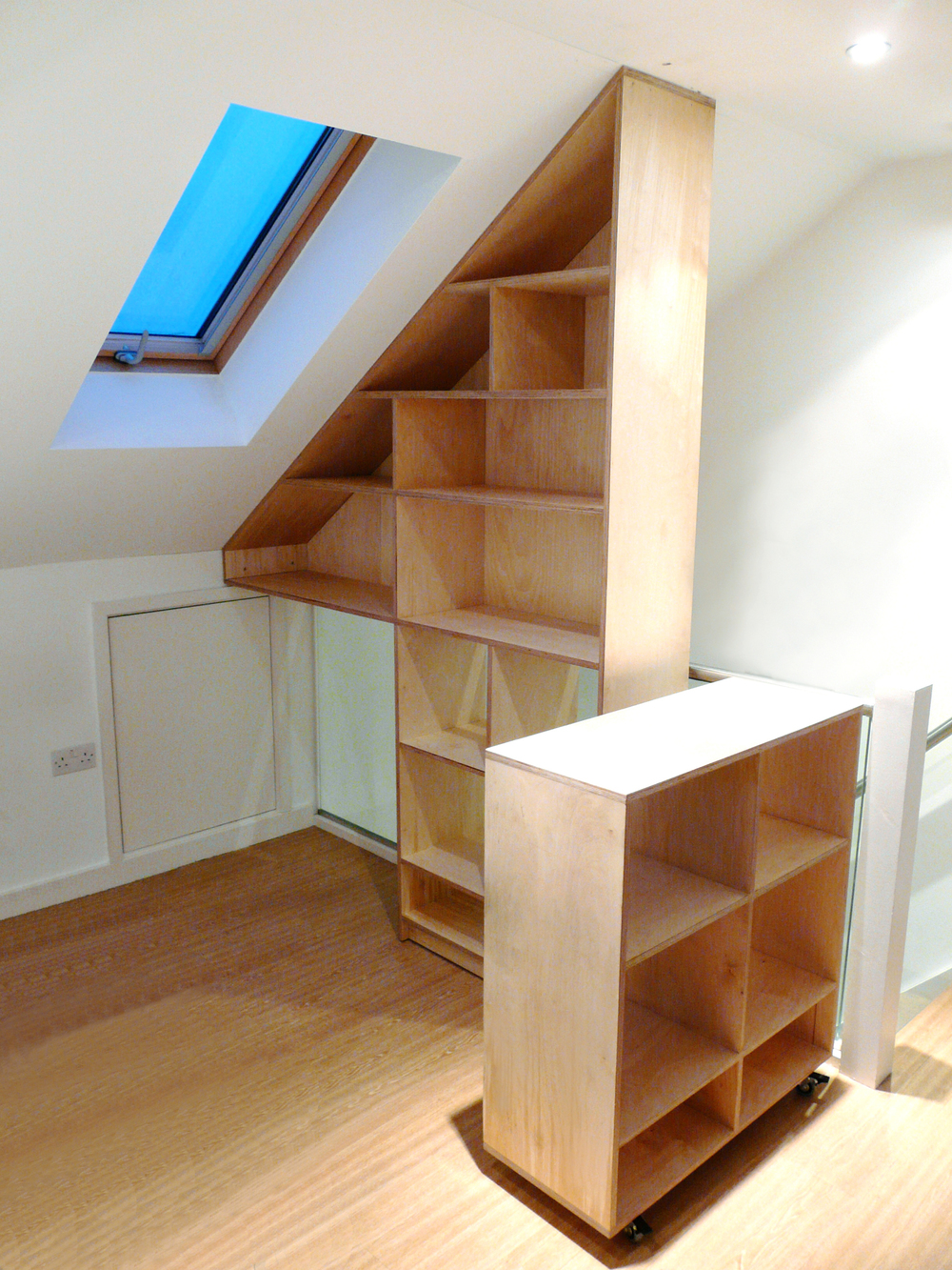 'Wedge' loft room shelving - birch plywood.jpg