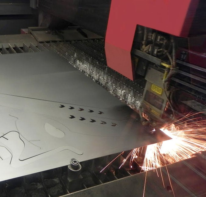 Laser cutter machine cutting out metal sign