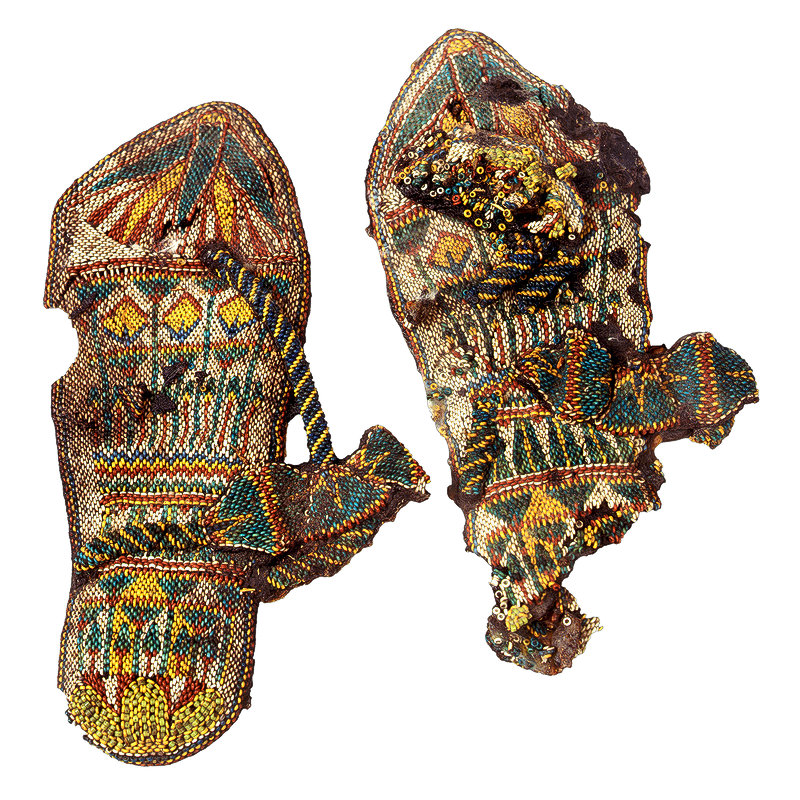 Beadwork sandals of King Tutankhamun (ruled ca. 1332-1323 BCE) showing lotus, papyrus and dom palm motifs.  While the    technique is probably peyote stitch, the materials are faience beads and leather. The sandals are preserved at the Egyptian Museum in Cairo as Catalog General No. 85 a-b. Image courtesy Egyptian Museum, Cairo.