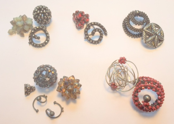 What's sitting on my table in the studio right now - mockups of new brooch ideas, using studio odds and ends and already-finished elements. Czech glass beads, sterling silver. Image Copyright Valerie Hector 2015.  All Rights Reserved.