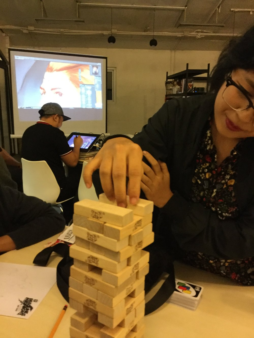 Justine Cruz gets the demo chair as a game of jenga plays on behind him.