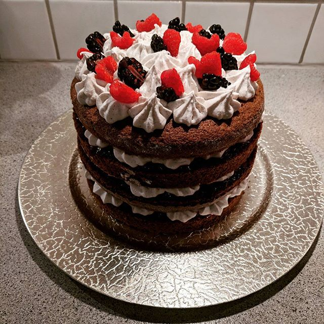 My take on a #blackforestgateaux Carob and vanilla flavoured chiffon sponge layered with winter berry jam, whipped coconut cream and fresh berries. It was totally light, delicious and absolutely #glutenfree and #dairyfree 🎂 #birthdaycake #carob #coconut #berries #lovebaking 😋