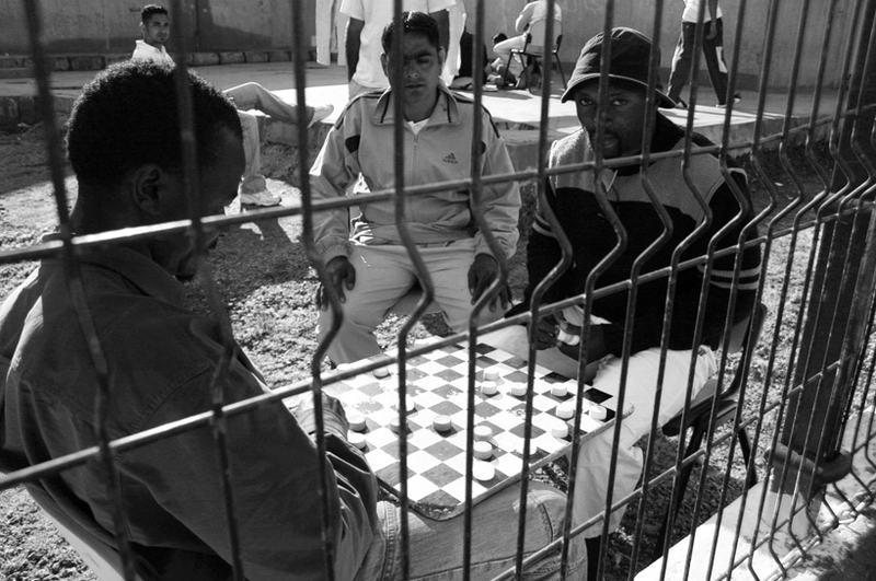 Migrants play checkers to pass the time. Migrants spend anywhere from a couple of months to a couple of years living in this CETI detention center awaiting either papers or deportation.