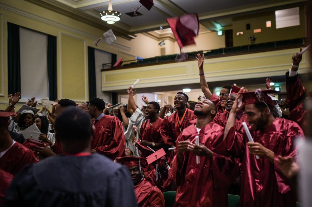 Excel Academy seniors throw their caps in the air after the graduation ceremony. (Salwan Georges/The Washington Post)