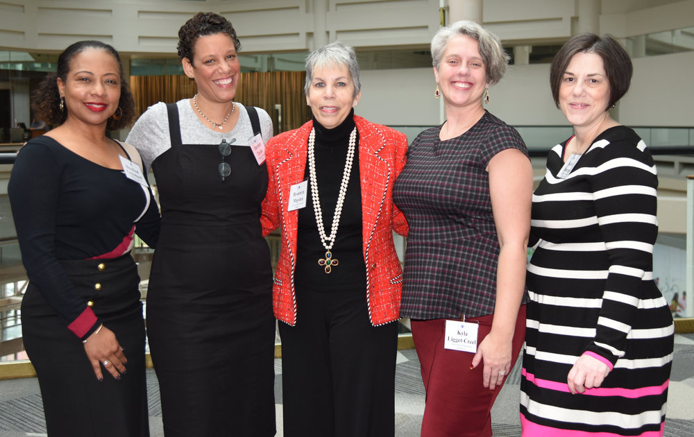 From left, Rosalind Lockwood, Executive Director, Furman L. Templeton Preparatory Academy; Henriette Taylor, Director of Community Schools, Promise Heights; Brownyn Mayden, Executive Director, Promise Heights; Kyla Liggett-Creel, Director of Research and Evaluation, Promise Heights; and Rachel Donegan, Assistant Director, Promise Heights. (photo credit: Mary Phelan)