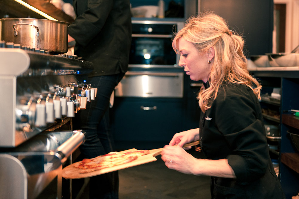 Albert Law - 052 - Chef Caroline with pizza.jpg