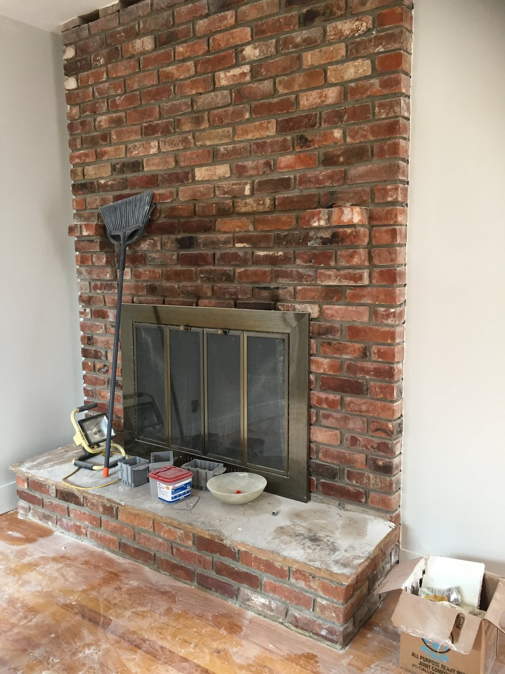 We come across a lot of brick fireplaces some of them are in great condition and don't need any work, but some just need to be refreshed! We love to paint fireplaces or white wash them. In this case we went with a cement application.