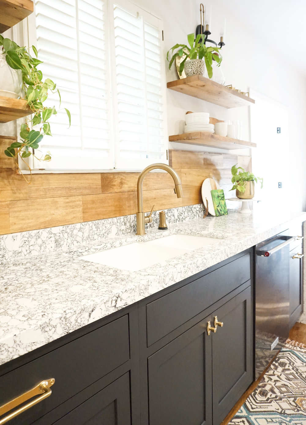 Open reclaimed wood shelves from Goodwood Nashville. Wood plank backsplash that has been stained (Minwax Early American) and sealed. Faucet, Delta.