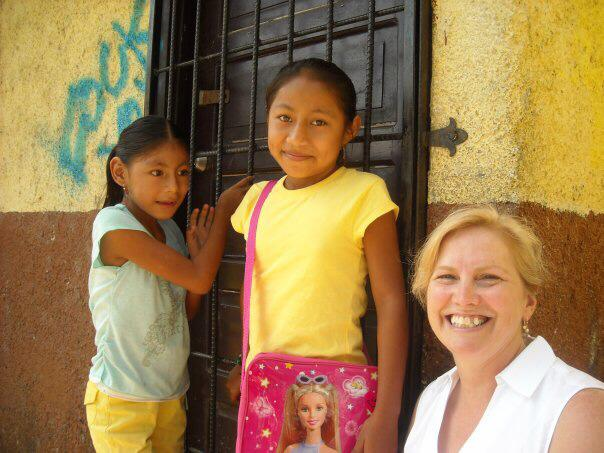 Elevat Co-founder Julie Johnson with sponsored child and her sister