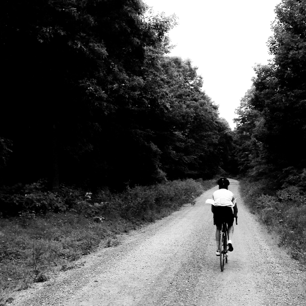 Black and White Rapha Ride on Gravel Road