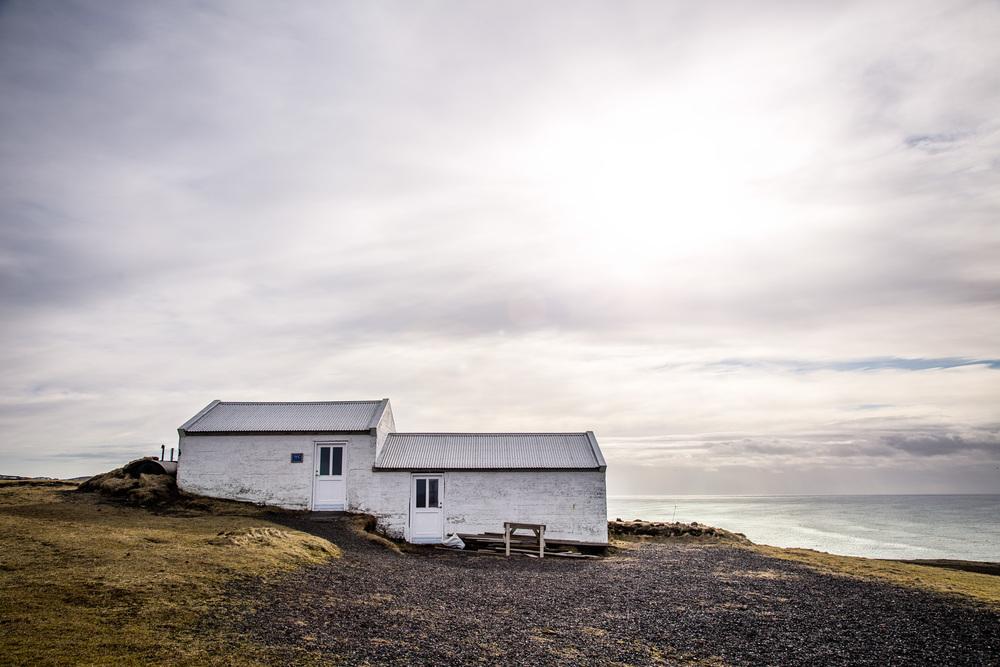 Buildings at Dyrhólaey overlooking ocean.