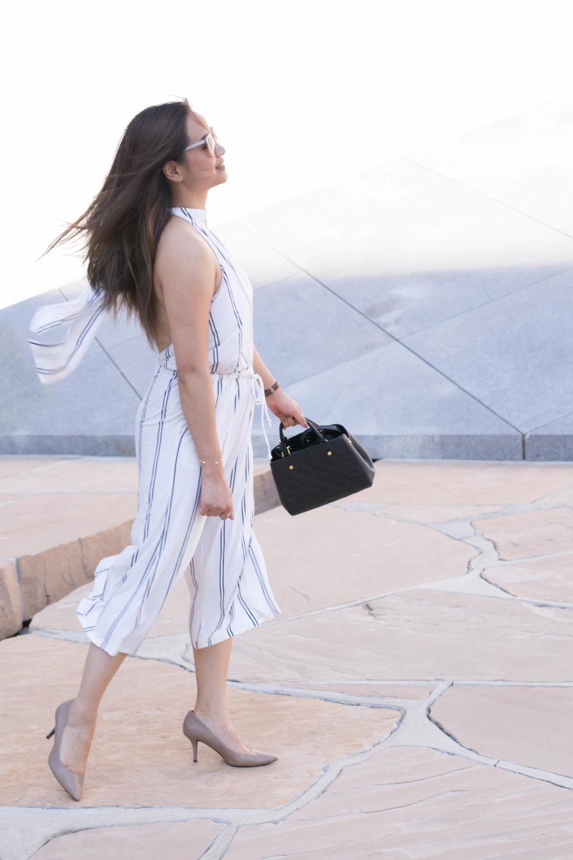 Romper:NastyGal Stripe Her Down Romper Bag:Louis Vuitton Empreinte Montaigne BB Heels: Kenneth Cole; similar here Sunglasses:Oscar de la Renta 215