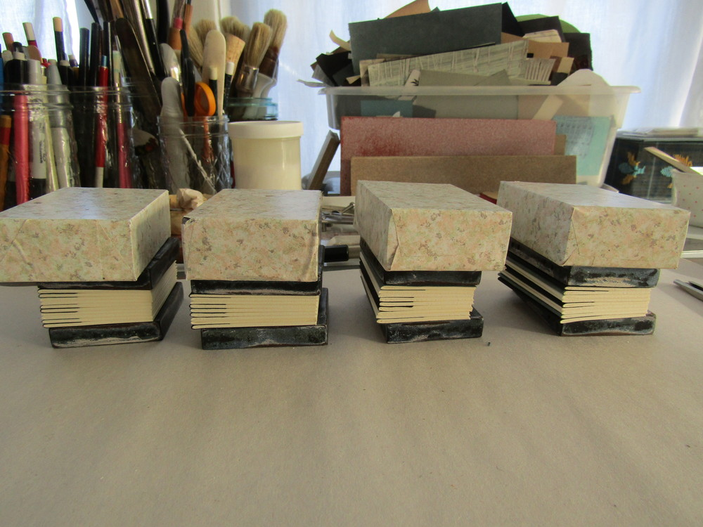 The text blocks are assembled and the sewing stations have been added using an awl - the books are now ready for sewing!