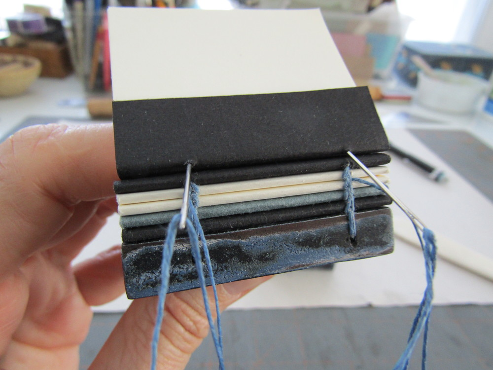 Sewing using two needles and waxed linen thread.
