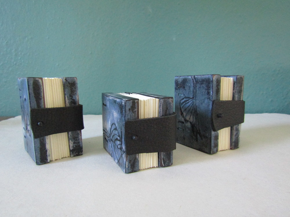The leather and wood closures work well as a way to hold the books together.