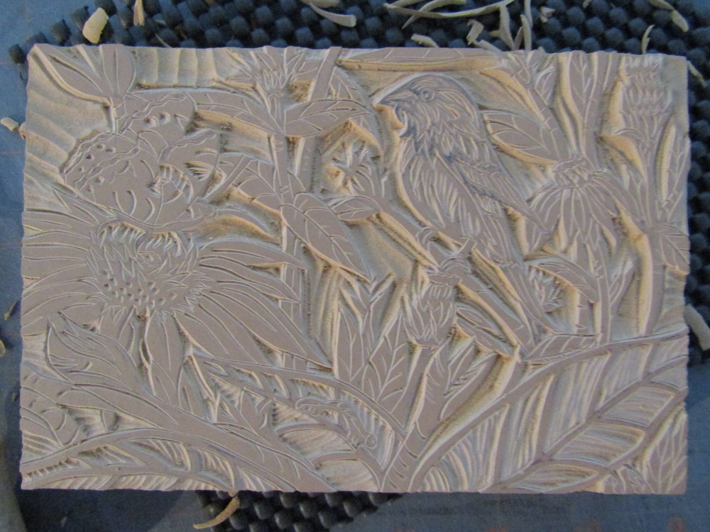 Carving the linoleum block for the relief print.