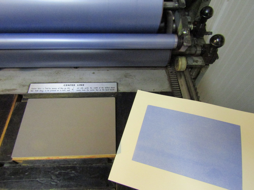 First run on the Vandercook - a blue mat. I used Stonehenge paper, quite nice for printing.