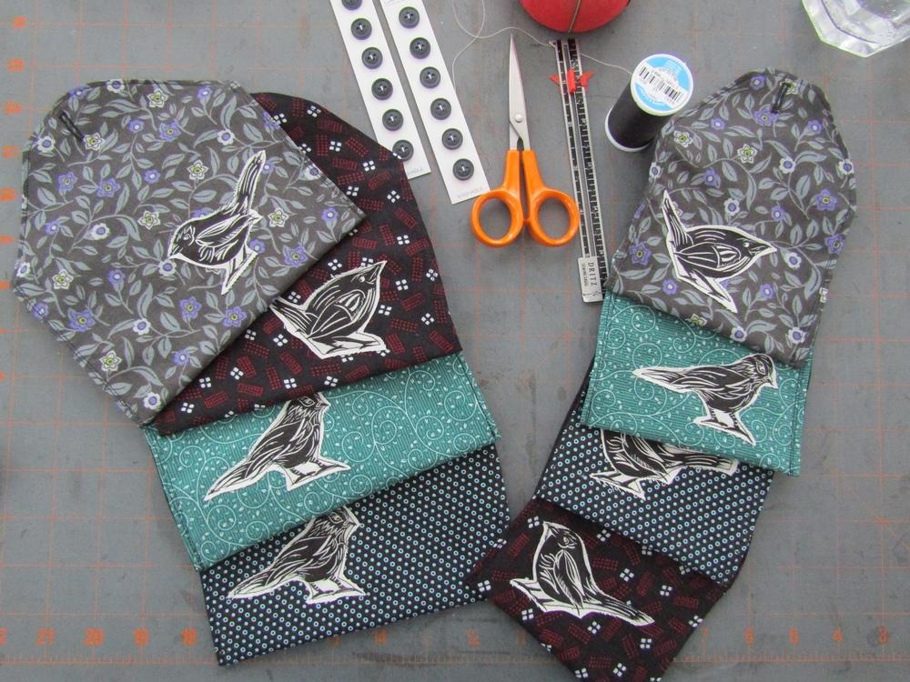 Purses are sewn up - adding the button closure.
