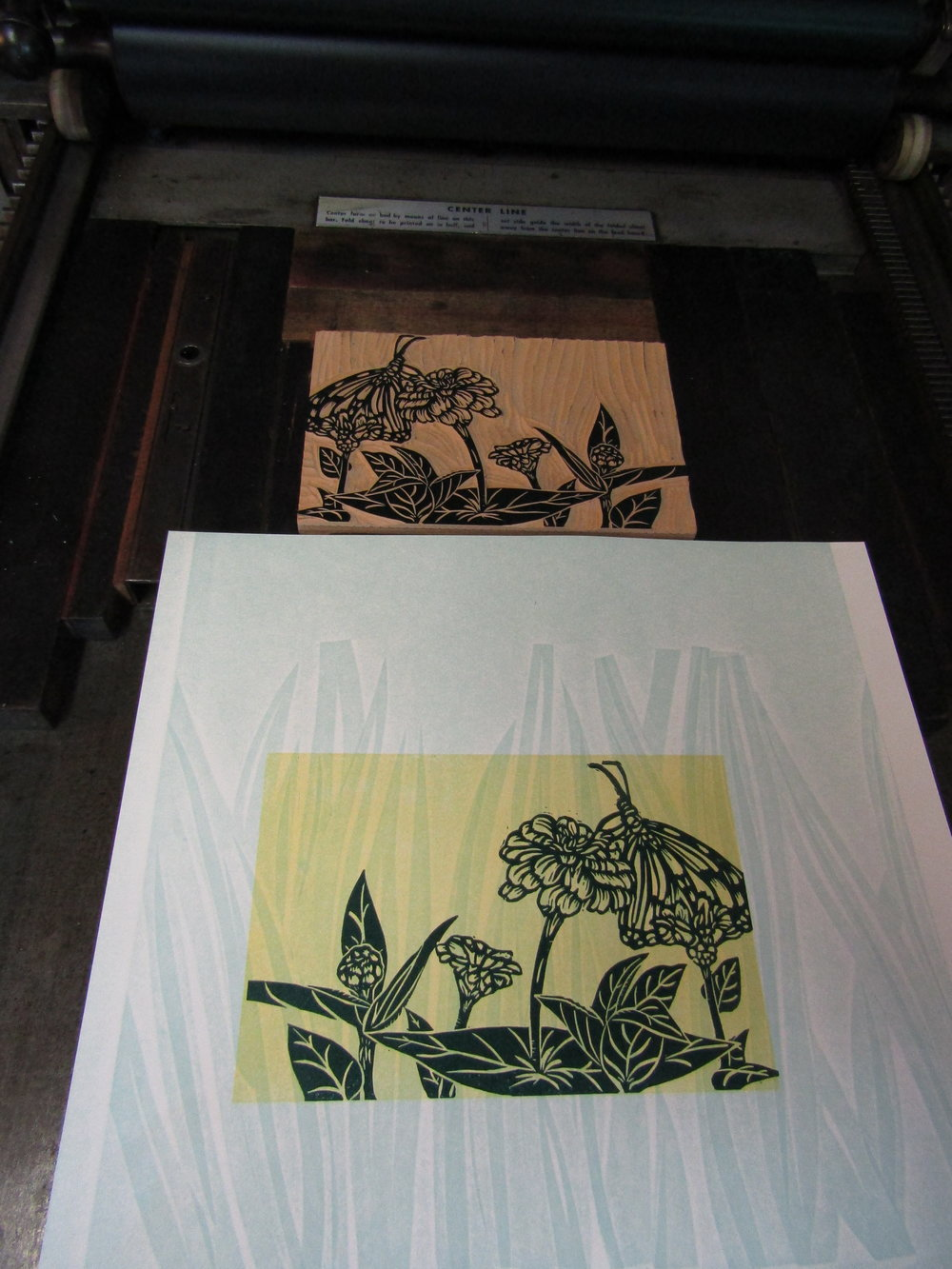 Print of a monarch butterfly in zinnias.
