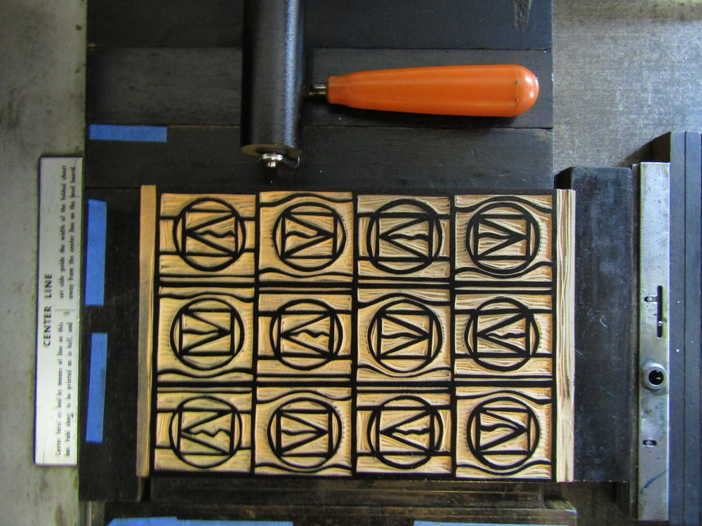 I ink the blocks using a brayer.
