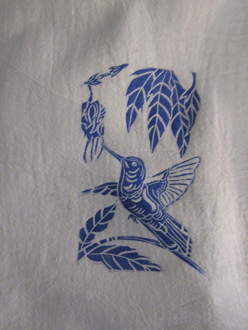 A little hummingbird adorns this towel.