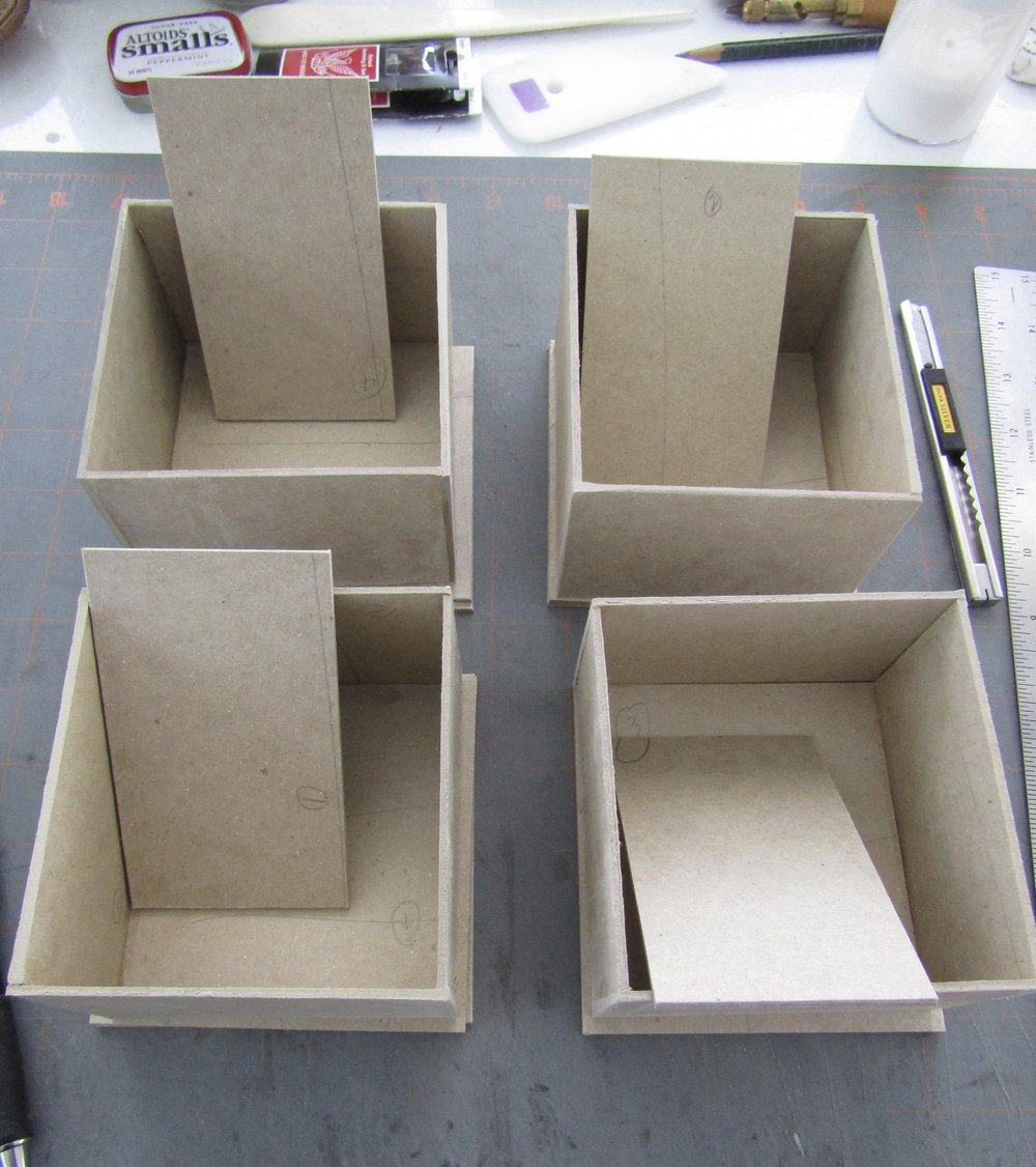The trays are sanded and built using PVA. I now begin the really fun part - covering with various papers!