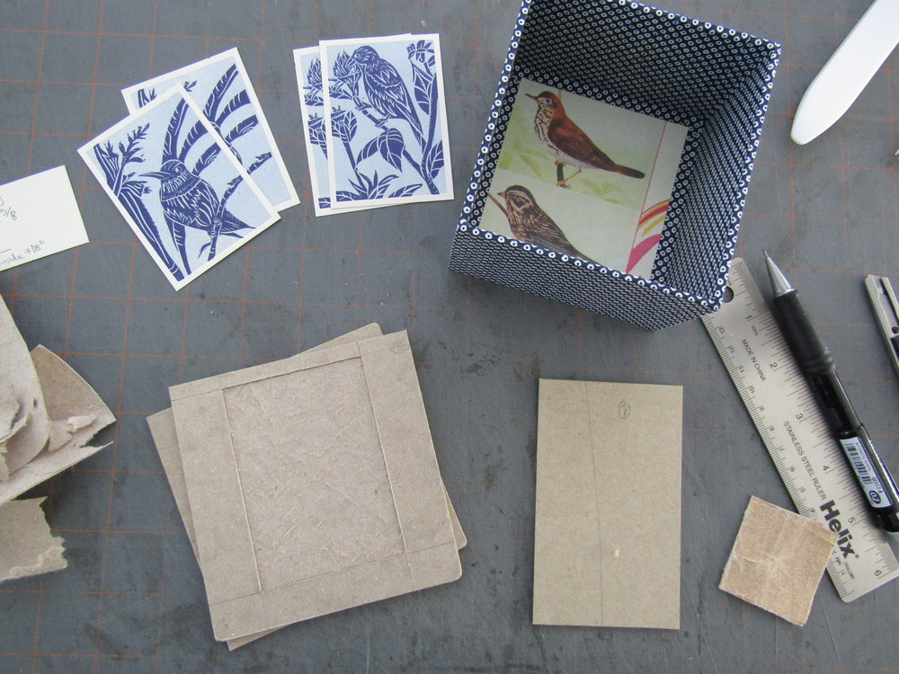 I cut a recessed area in the lid portion of the case before covering them. I did this for the letterpress printed relief prints I would place on the lid, once the boxes were completed. Lots of planning goes into making boxes.