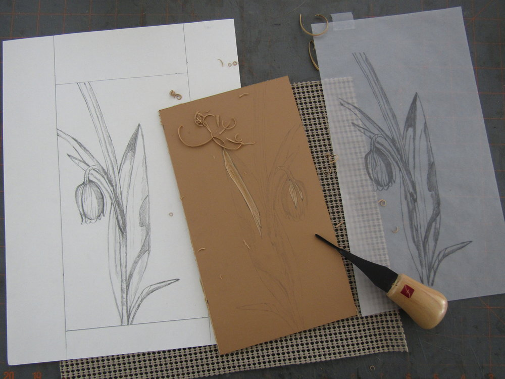 I began with the Fritilaria. Here I have transferred the sketch to the linoleum and am carving the image. I will leave these areas white on the completed print.