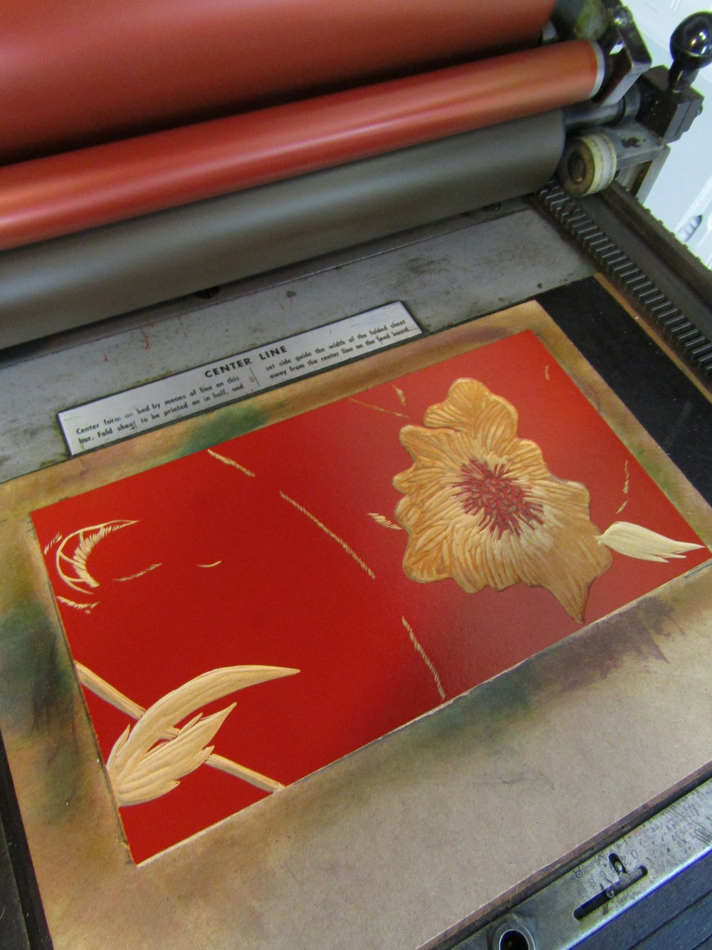 Most of the flower is carved away. Notice I left some in the center in order to give the flower portion of the print more depth as it will be the final and darkest color. I am also moving forward with the background and it is getting darker in color.