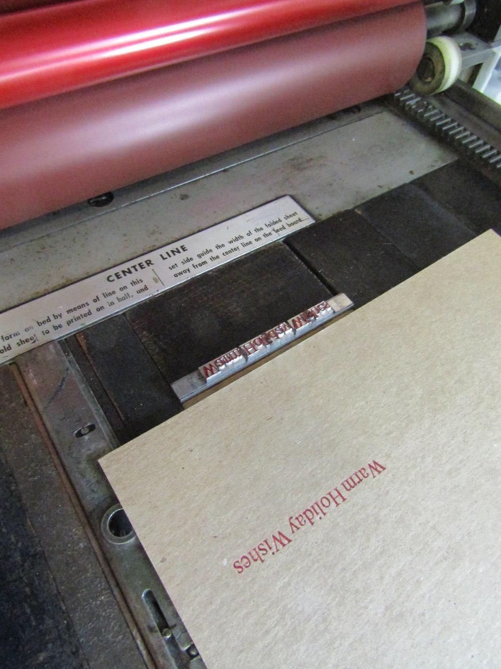 Printing the interior message using 24 pt Garamond metal type.