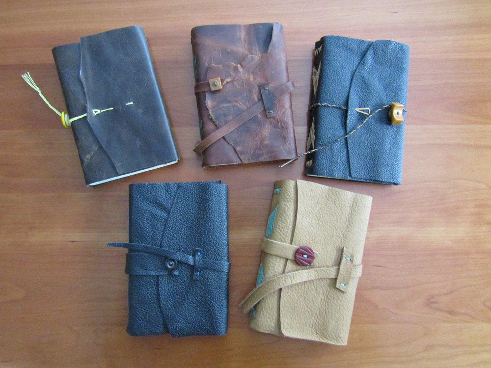 Completed books with covers and closures using vintage buttons.