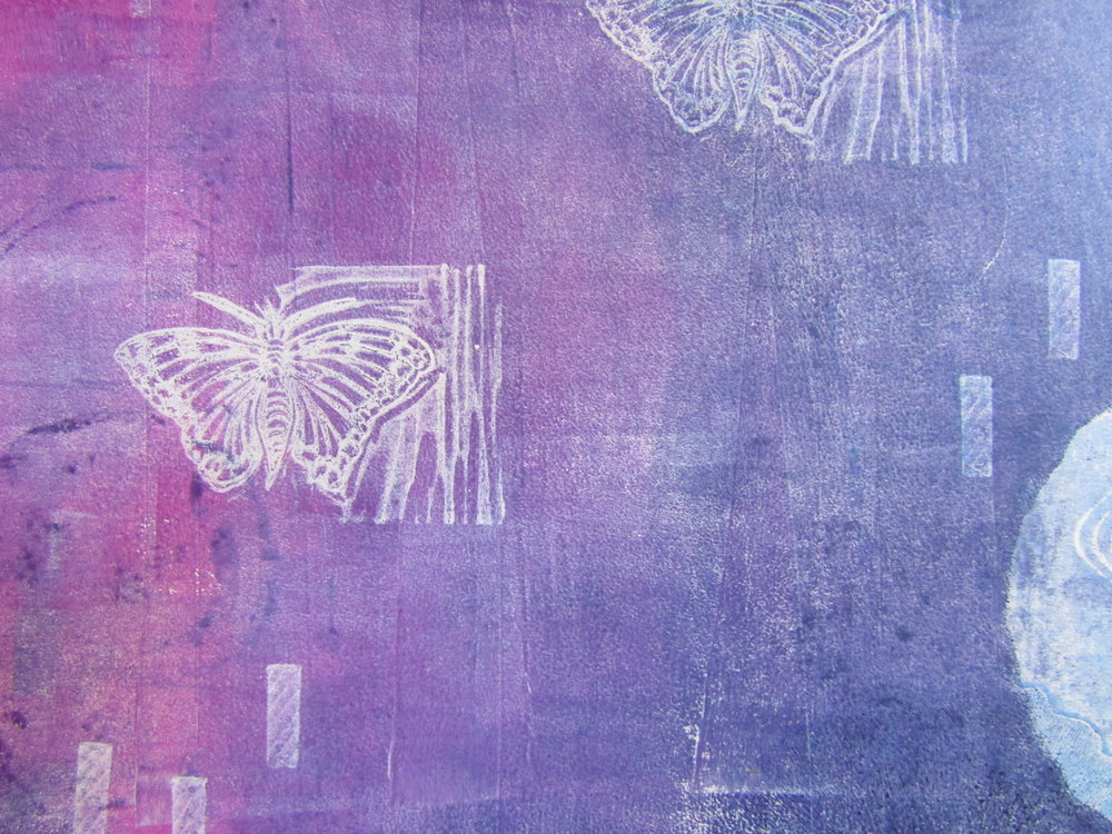 Notice how the butterfly image is the color of the paper. This happened because I pressed the relief block onto the pink and purple paints (removing them from the plate). Therefore the image printed the color of the paper when I pulled the print. I used a cover weight French paper.