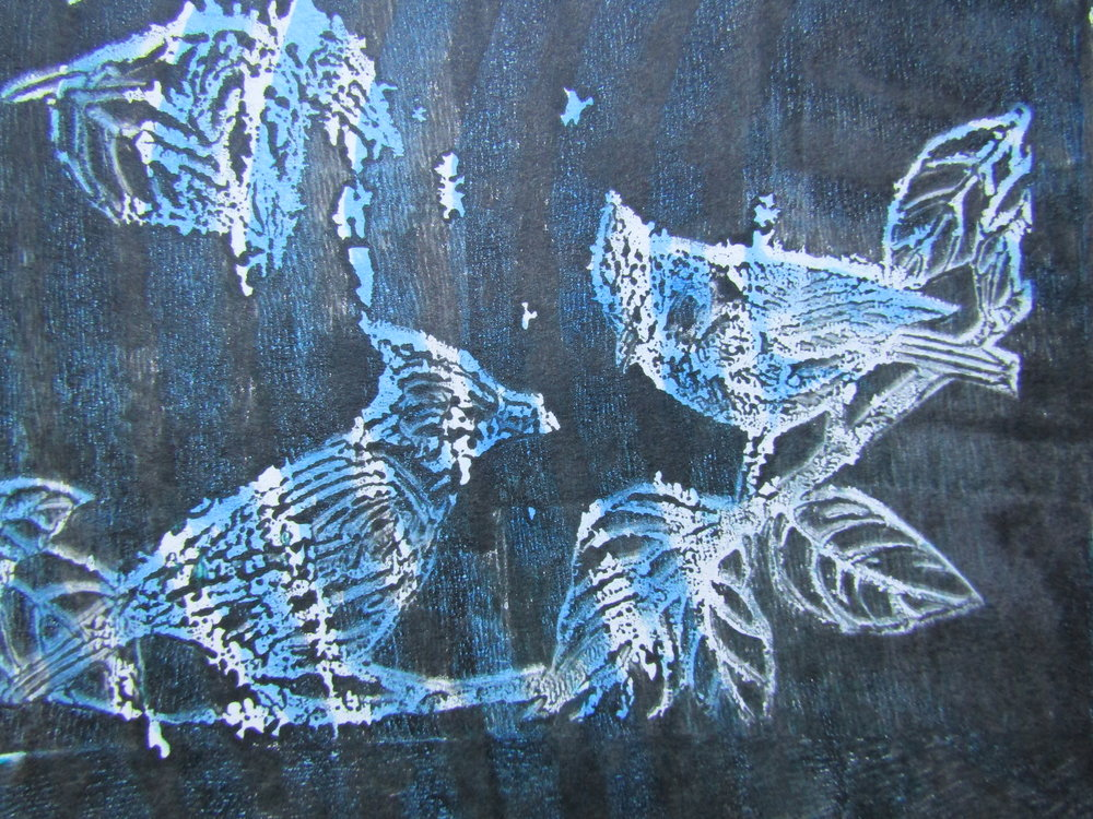 I built up layers of patterned blues and blacks onto the gelli plate. Then before pulling the final print I pressed this bird relief block onto the black paint. I love the ghost-like quality of the image.
