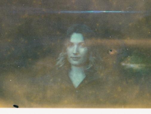 Expired Polaroid of my wife.