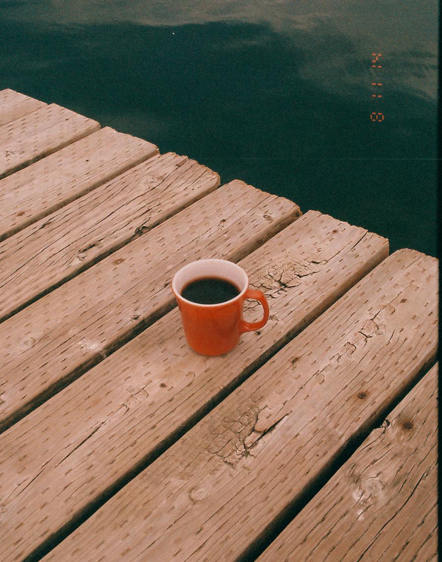 Orange coffee mug by  Lon.
