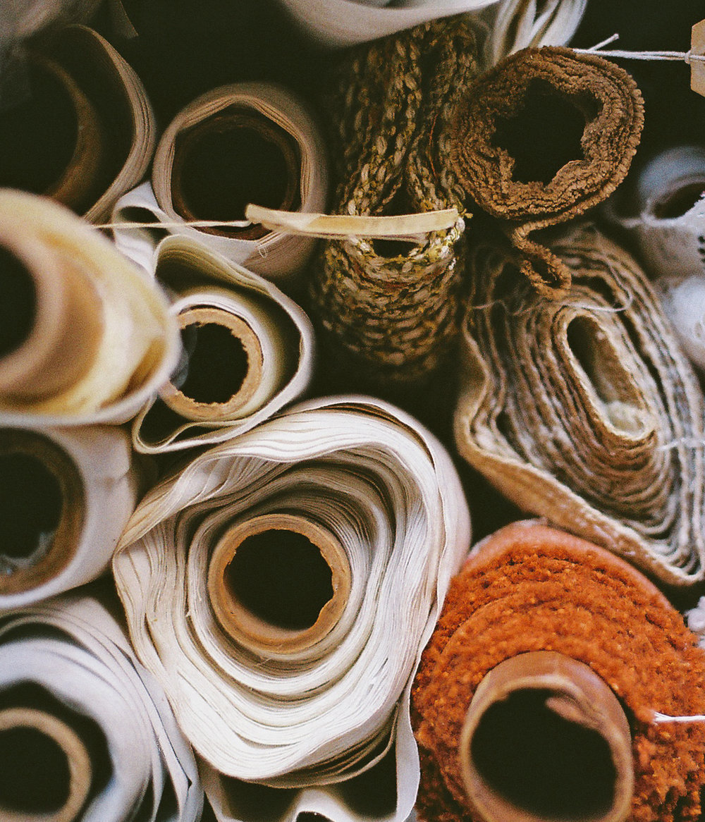 Rolls of fabric at the Stash Co.    factory in Houston Texas by    Lon  .