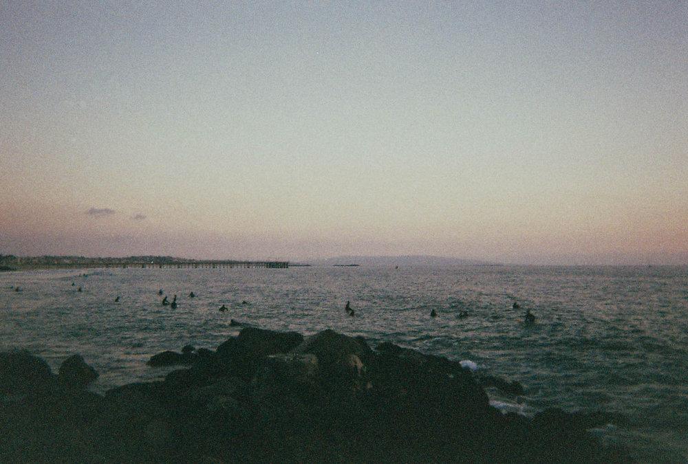 Surfers by  Lon.
