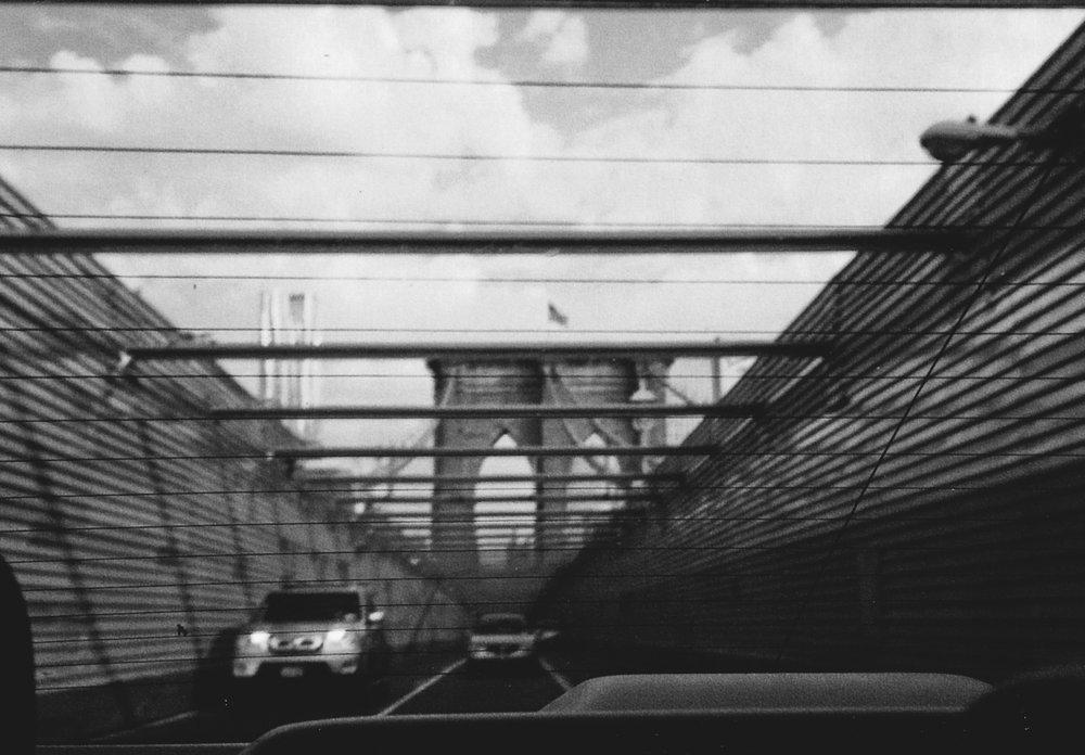 © LONNIE WEBB    The Brooklyn Bridge through my cab window
