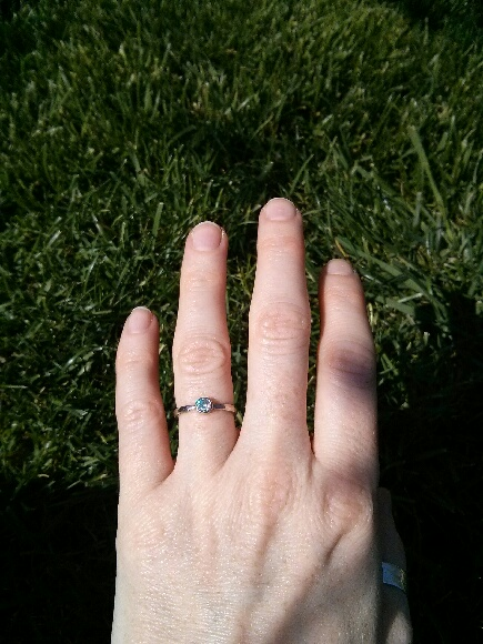 Christina's hand with her new Moissanite engagement ring - @sharonzjewelry #moissanite