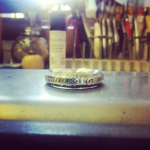 "Custom engraving on my Pine Bark ring for @tvcjosh ""equitare in aeternum"" #keepitmoving #equitareinaeternum #oneringtorulethemall #bikestyle"