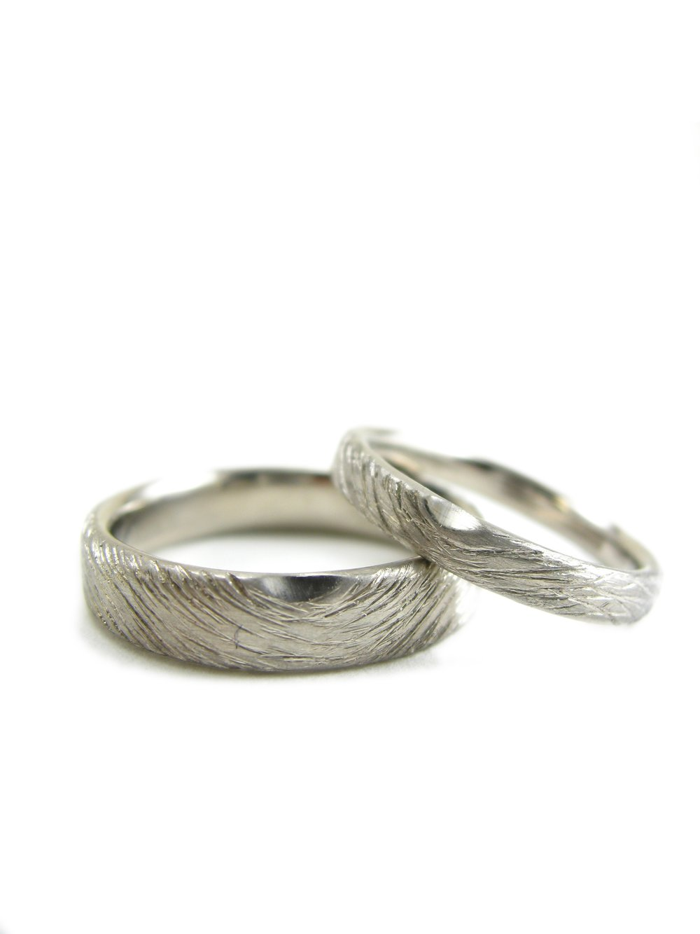 The finished rings. The bottom ring was created in a custom width. The top ring is available to order  here .