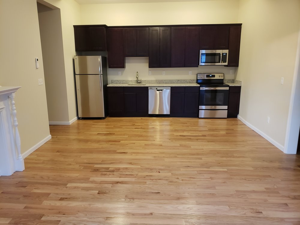 52 1B living room with kitchen.jpg