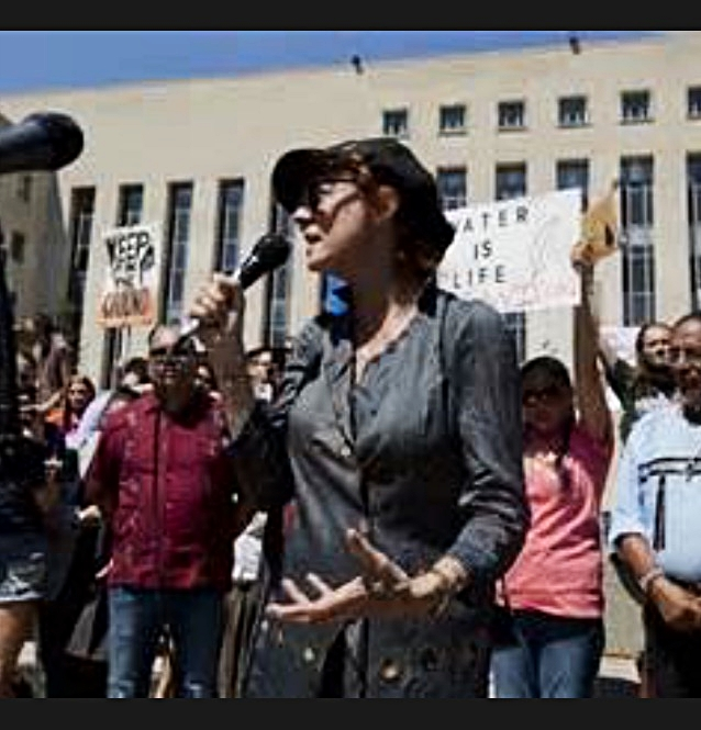 Susan Sarandon takes the mic at a protest.