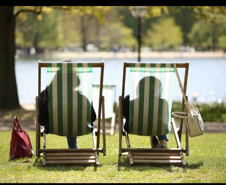 What's the betting that deckchair on the right is going to order that deckchair on the left go get the ice creams and 'stop being a whiny cow' - Bank holidays, huh