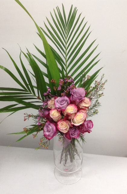 The OMG selection of mixed pink roses locally grown and hand tied by OMG designers . Comes with foliage and ribbons -$60