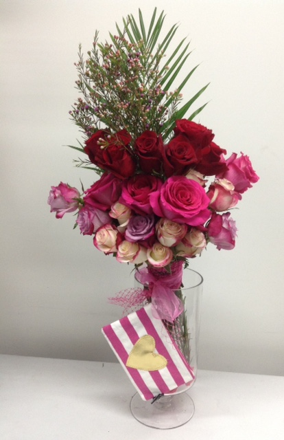 Two dozen mixed pink and red roses for that special someone, hand tied with a canvas cosmetic pouch to make this an everlasting gift -$ 100