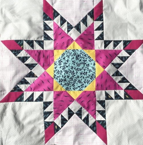 This block was eventually cut in fourths diagonally to make the lap sized quilt shown next...