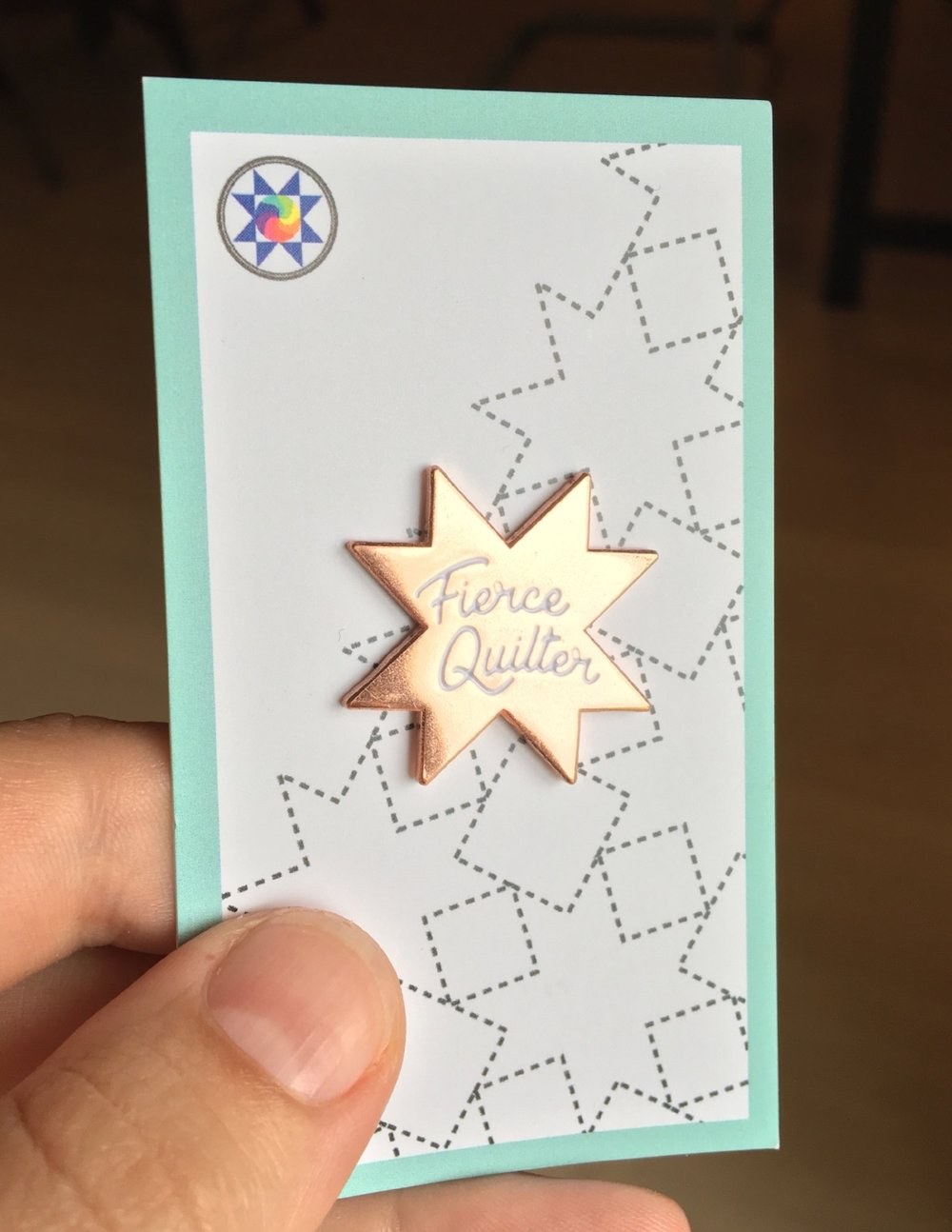 Click the photo to buy your own pin from Eye Candy Quilts! You might as well pick up a second pin for a fierce quilter friend!